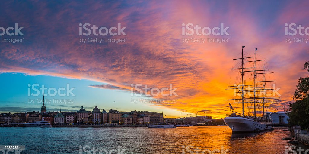 Stockholm sunset over Gamla Stan spires and ships panorama Sweden stock photo