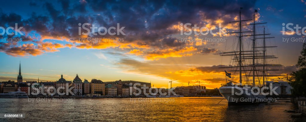 Stockholm sunset over harbour and Gamla Stan waterfront panorama Sweden stock photo