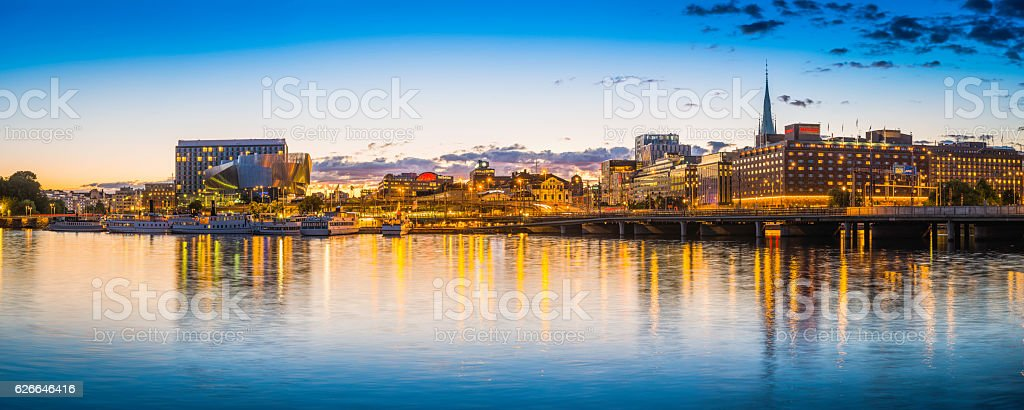 Stockholm sunset over Norrmalm harbour waterfront illuminated cityscape panorama Sweden stock photo