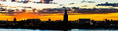 Stockholm sunset silhouette panorama golden skies City Hall waterfront Sweden
