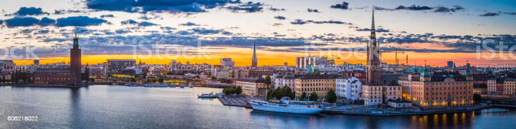 Stockholm sunset spires City Hall illuminated waterfront cityscape panorama Sweden stock photo