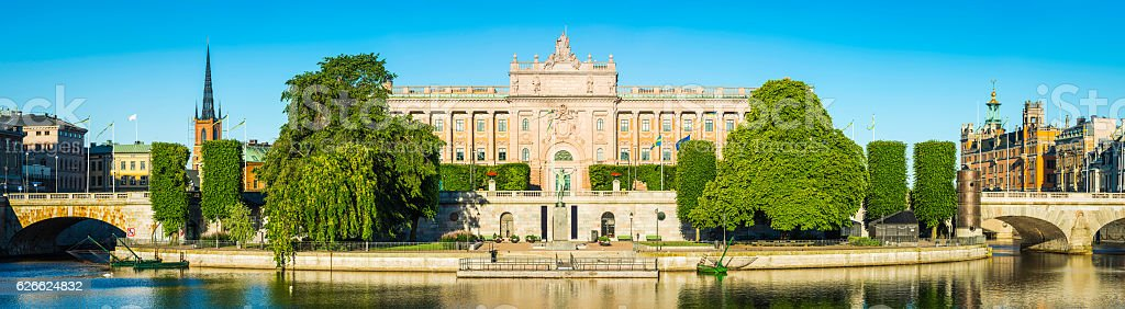 Stockholm Swedish Parliament Riksdagshuset panorama Gamla Stan waterfront sunrise Sweden stock photo
