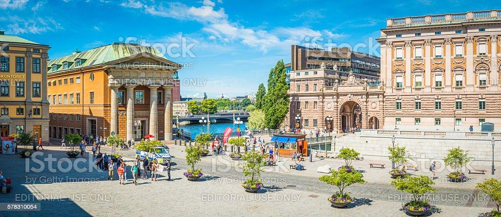 Stockholm tourists on Gamla Stan beside Riksdagsjuset parliament panorama Sweden stock photo