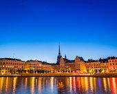 Stockholm warmly illuminated restaurants townhouses spires Gamla Stan waterfront Sweden