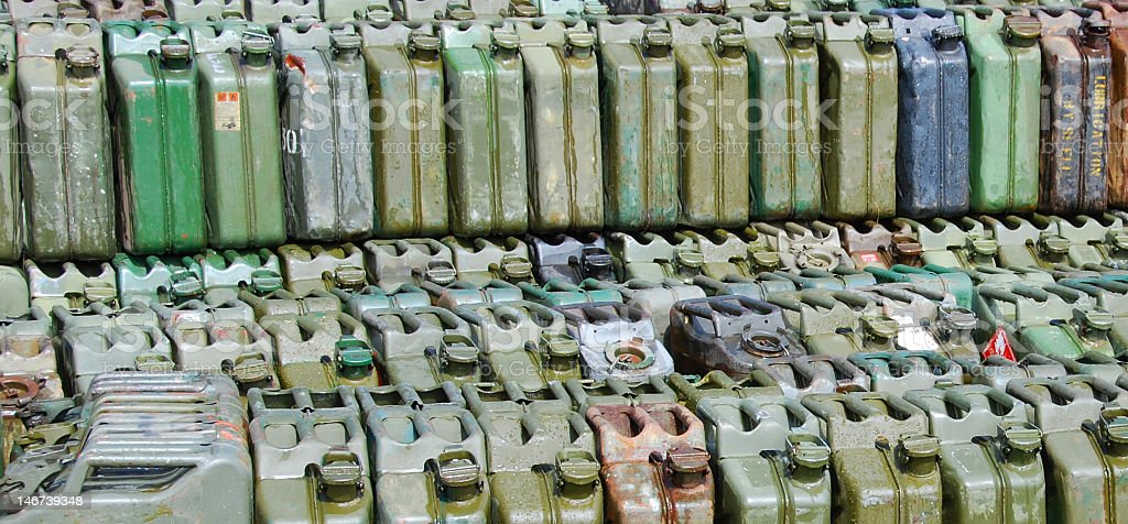 stockpile of petrol cans stock photo