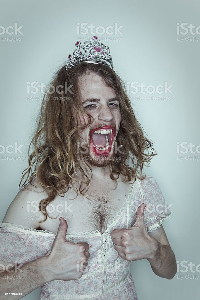 Stoked Male Prom queen in drag tiara on head lipstick stock photo