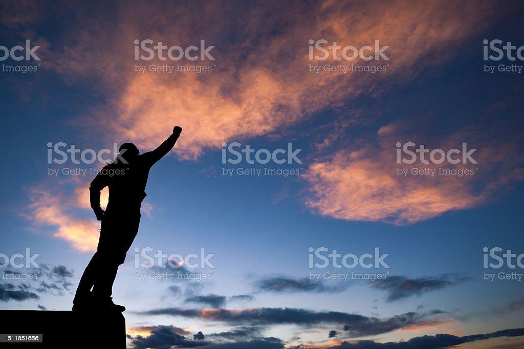 stoked man silhouette sunset stock photo