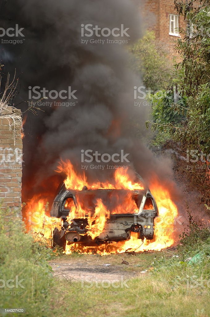Stolen car on fire in alley way stock photo
