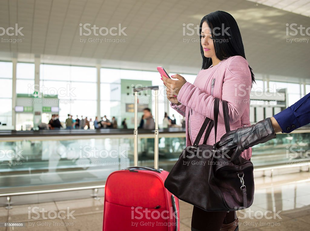 stolen woman in an airport stock photo