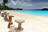 Stolls and tables from tree trunks. Port Olry beach-Vanuatu. 7024