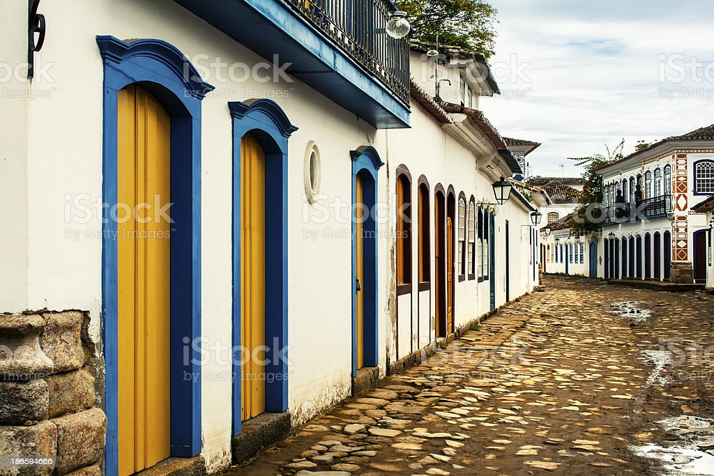 Stone and dirt walkway along houses in Parati, Brazil stock photo