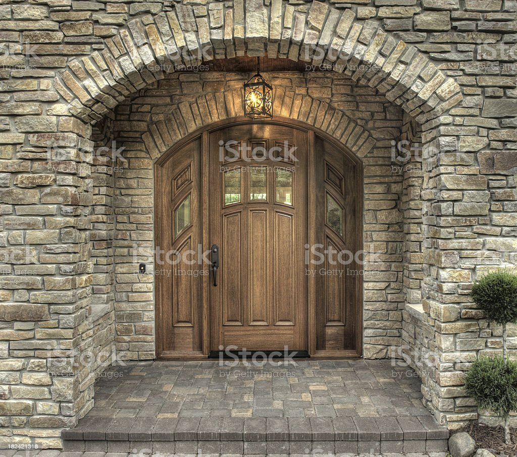 Stone and paver arched entry door. royalty-free stock photo