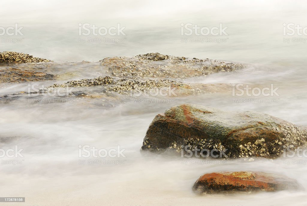 Stone and sea wave stock photo