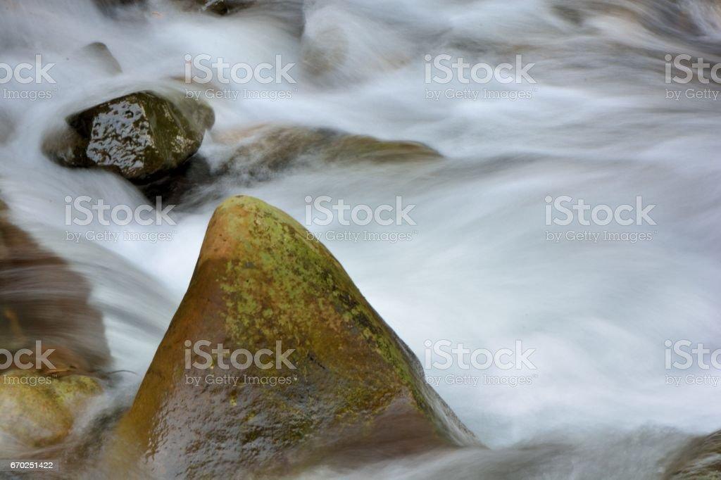Stone and stream stock photo