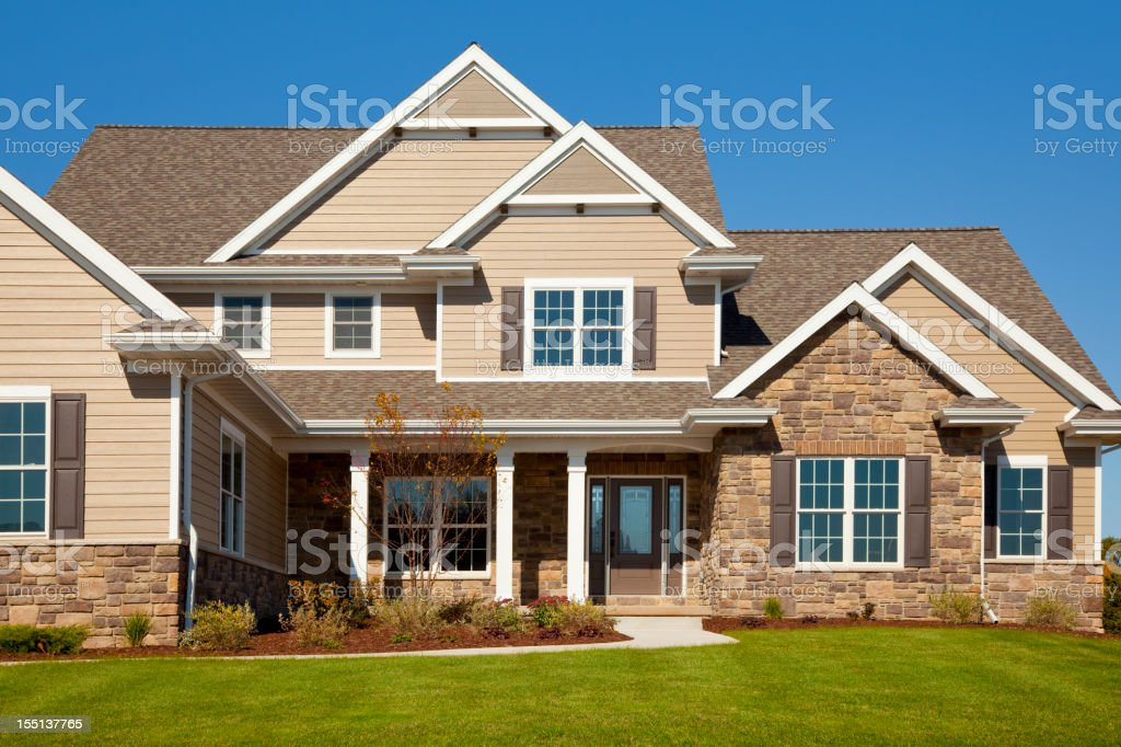 Stone and Vinyl House With Cedar Accents stock photo