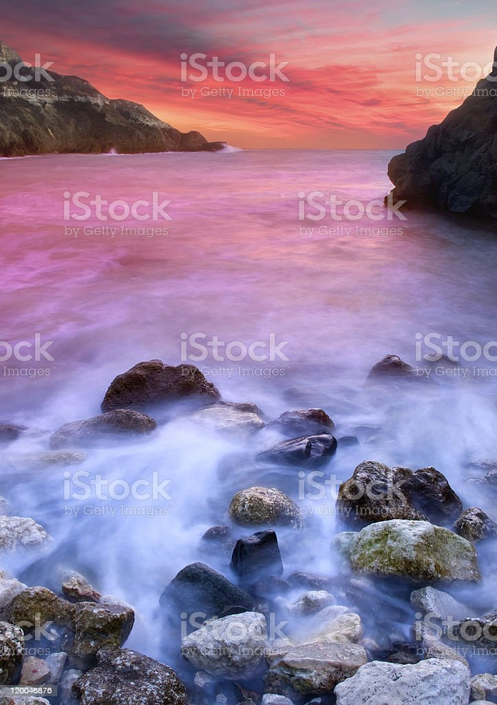 Stone and white waves royalty-free stock photo