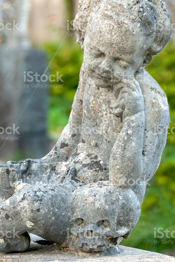 Stone angel statue in ancient cemetery II stock photo
