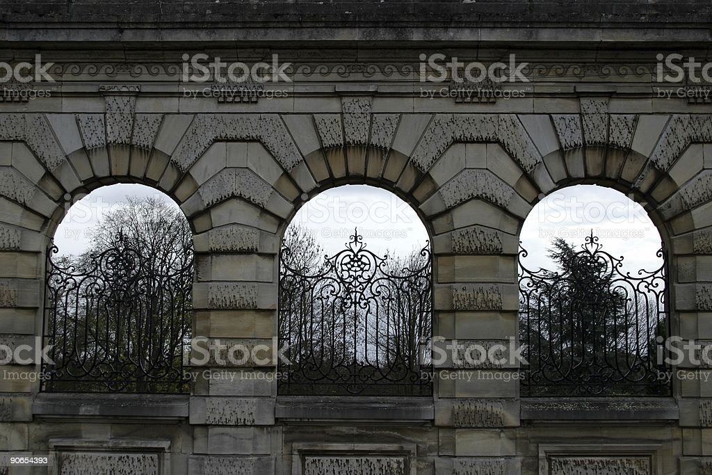 stone arch and iron fence royalty-free stock photo