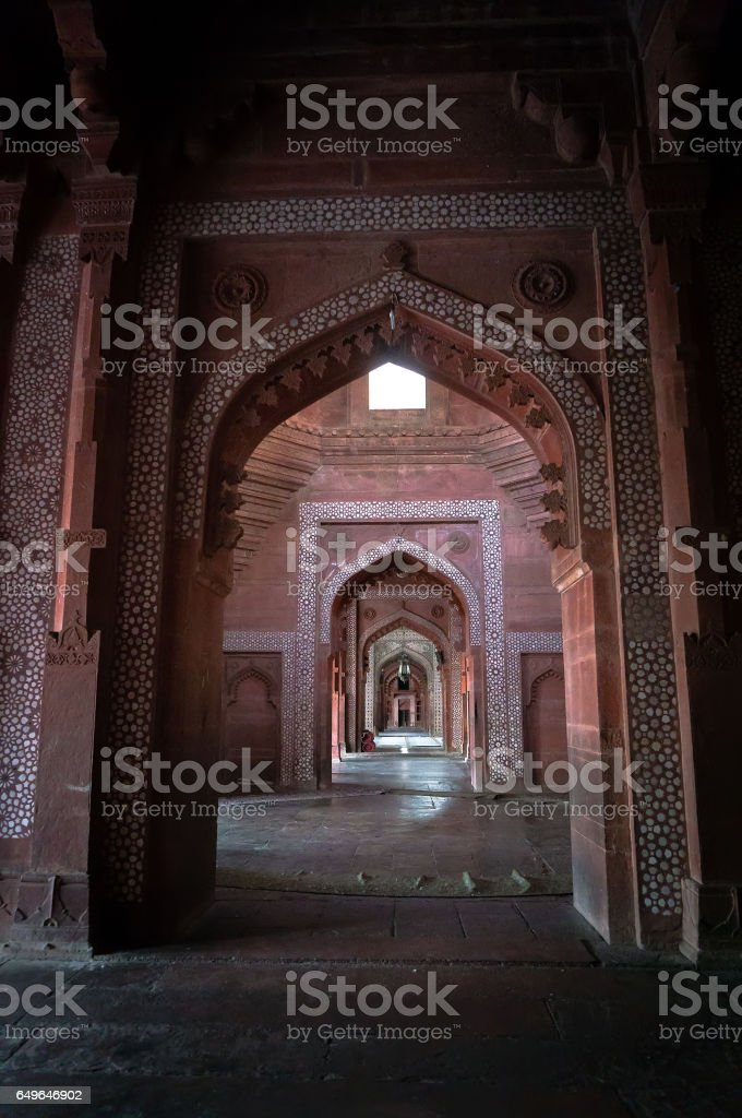 FATEHPUR SIKRI A stone arch of red sandstone leads out of the Emperor' stock photo