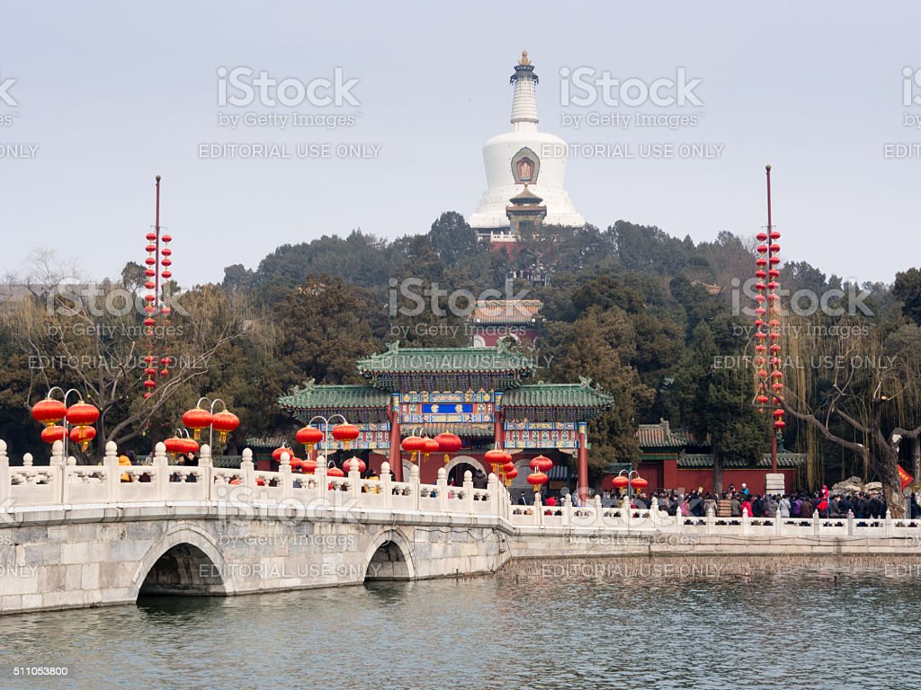 Stone arched bridge and white pagoda at Beihai park stock photo