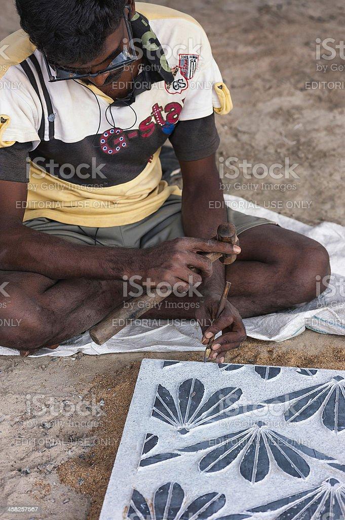 Stone artisan sculpting , Mamallapuram, Tamil Nadu, India. royalty-free stock photo