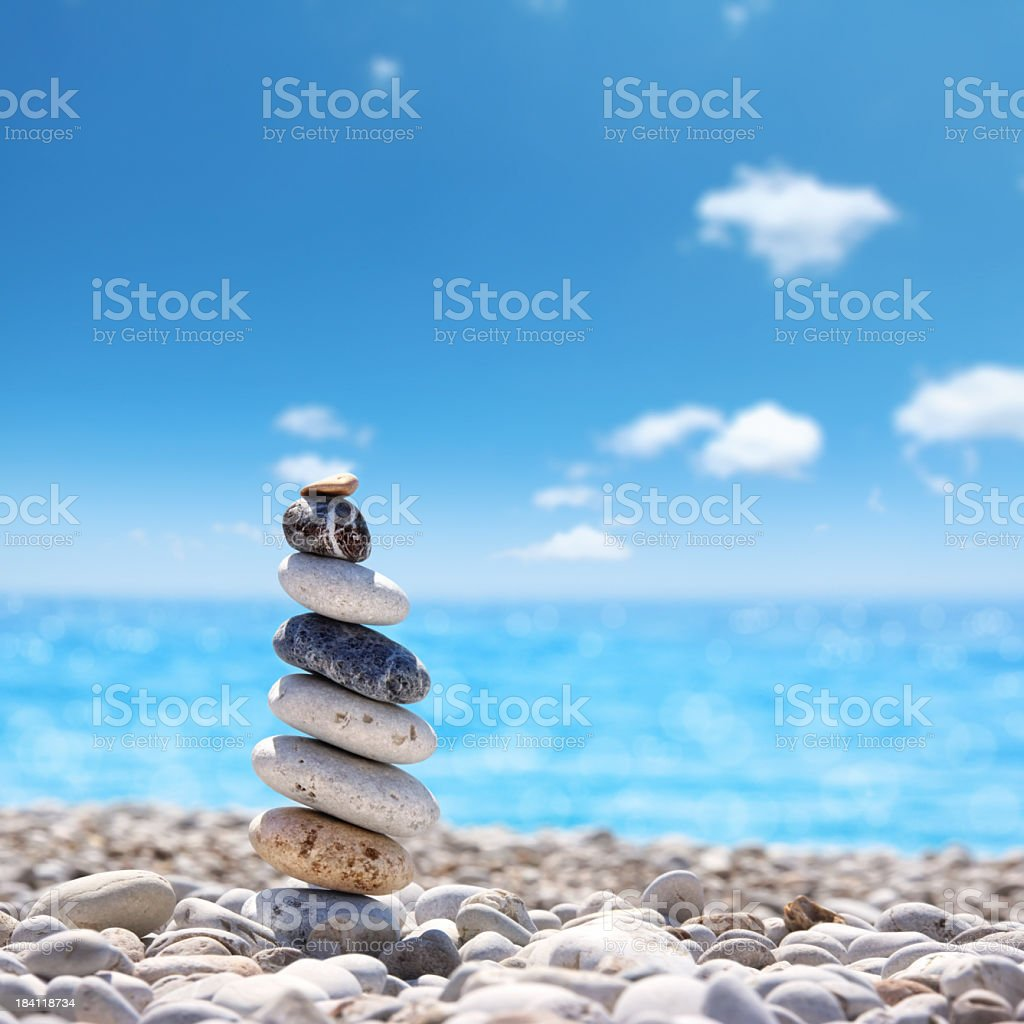 stone balance on beach stock photo