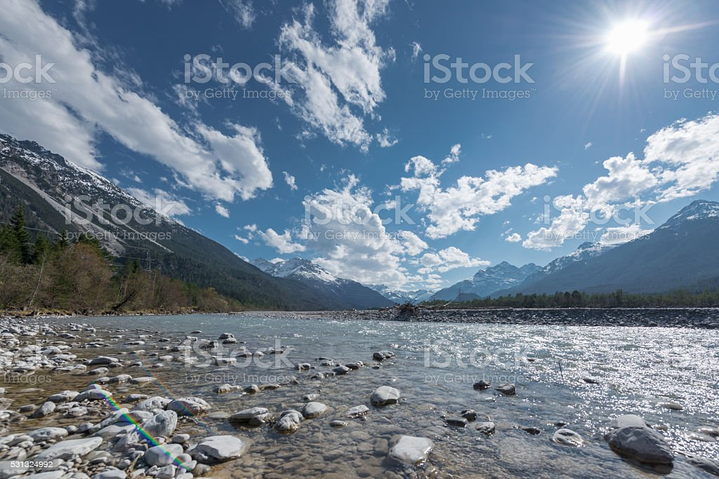 stone bank at flowing river lech in tirol lechtal stock photo