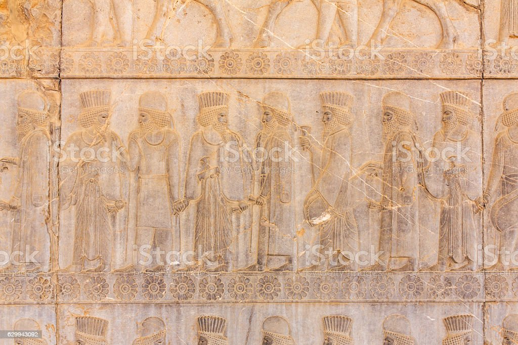 Stone bas-relief in ancient city Persepolis, Iran. stock photo