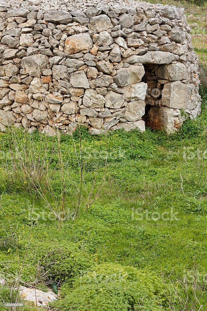 stone beehive capanne/case su Malta foto stock royalty-free