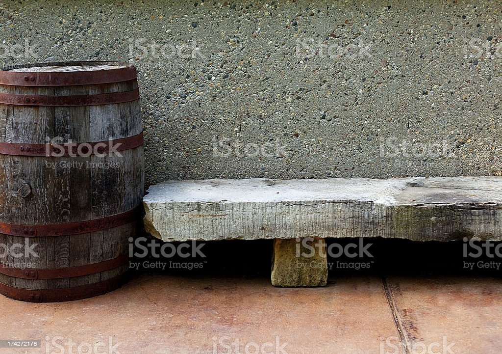 stone bench with barrel royalty-free stock photo