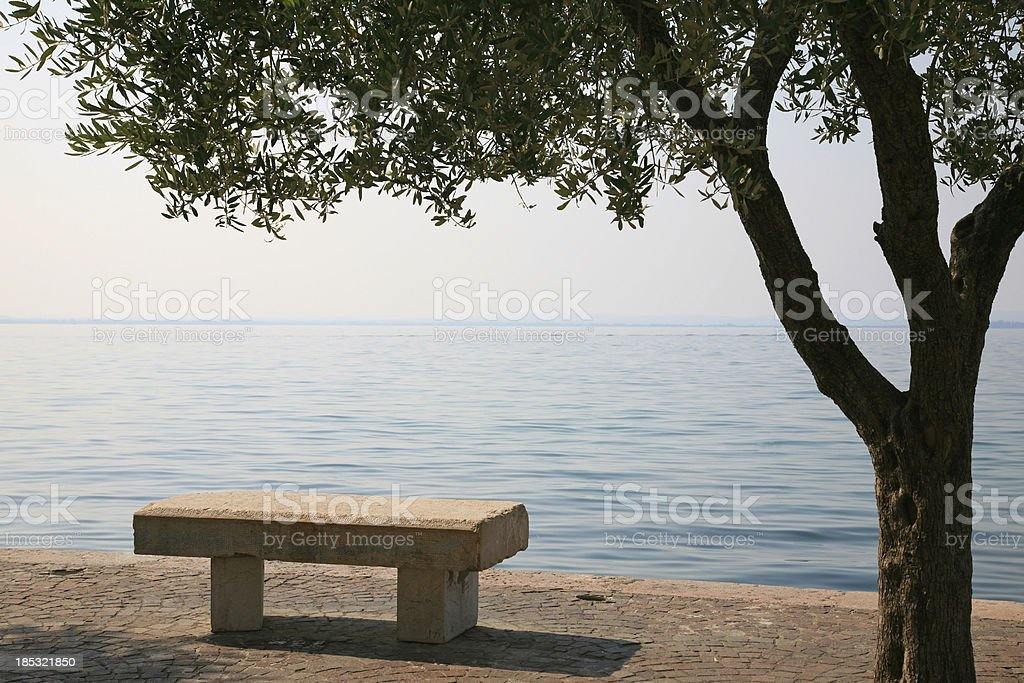 Stone bench with view on Lake Garda in Italy royalty-free stock photo