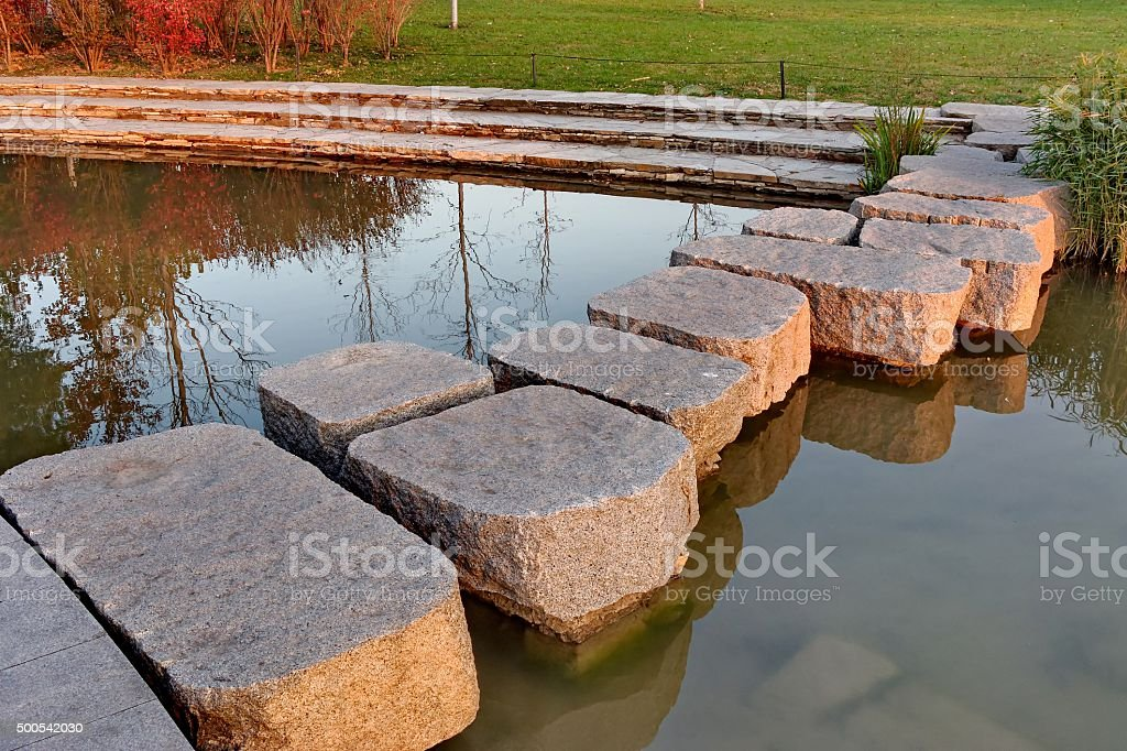 stone block road in the water stock photo