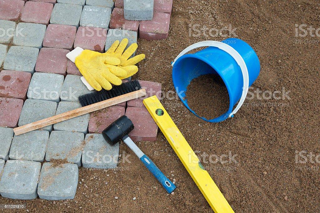 Stone blocks rubber hammer level gloves and tape measure stock photo