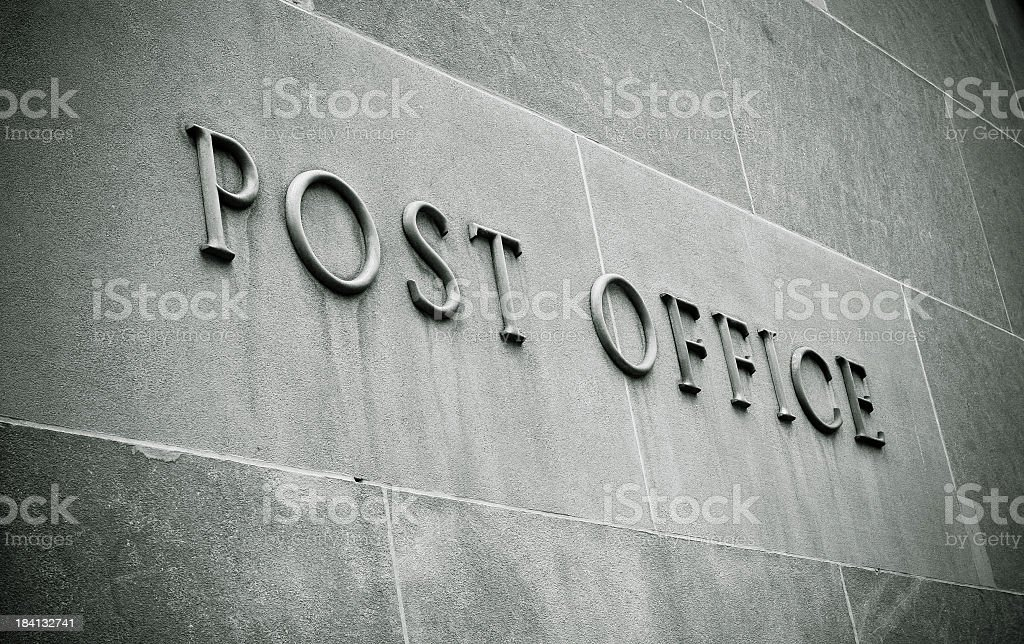 Stone blocks with lettering reading Post Office stock photo