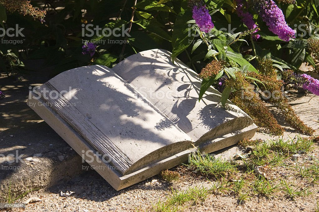 Stone Book in the garden stock photo