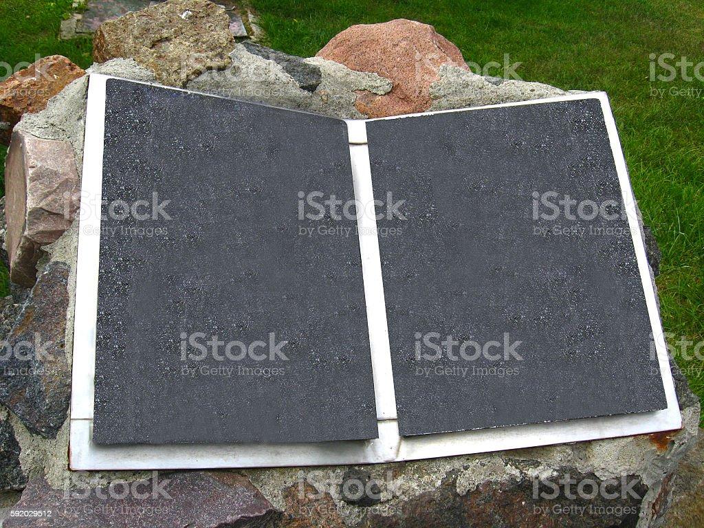 Stone book on front garden stock photo