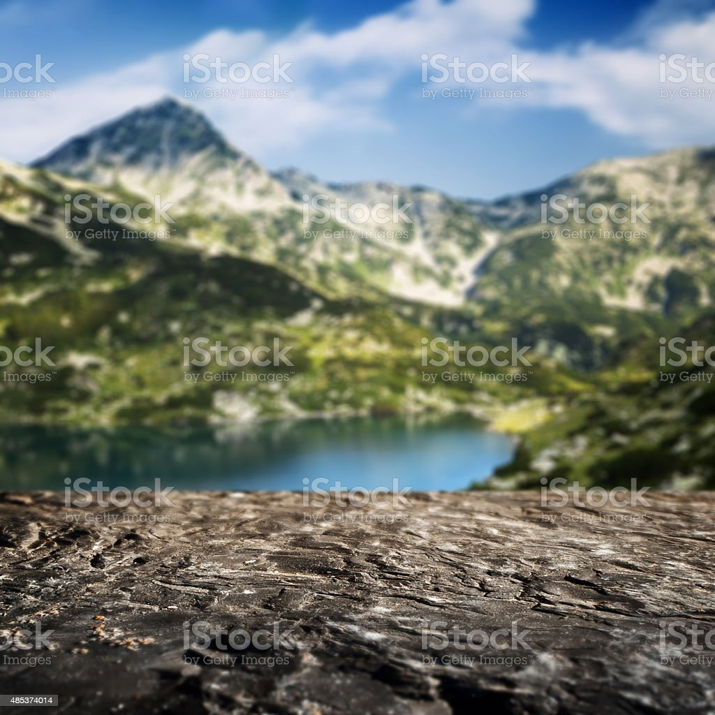 Stone border and defocused mountain landscape on background stock photo
