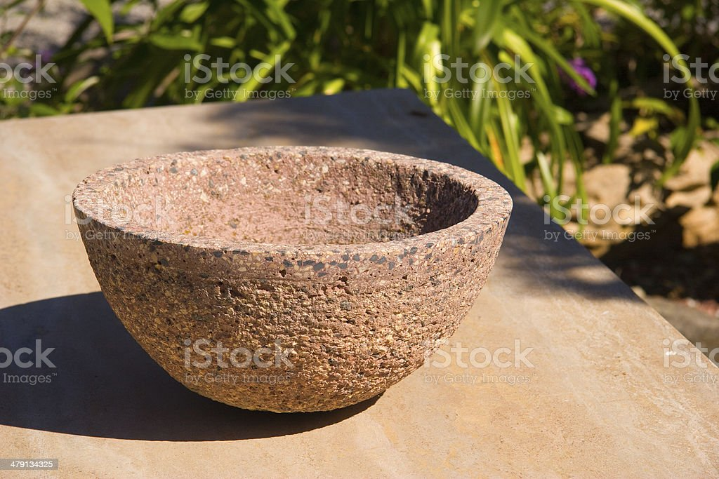 stone bowl in the garden stock photo
