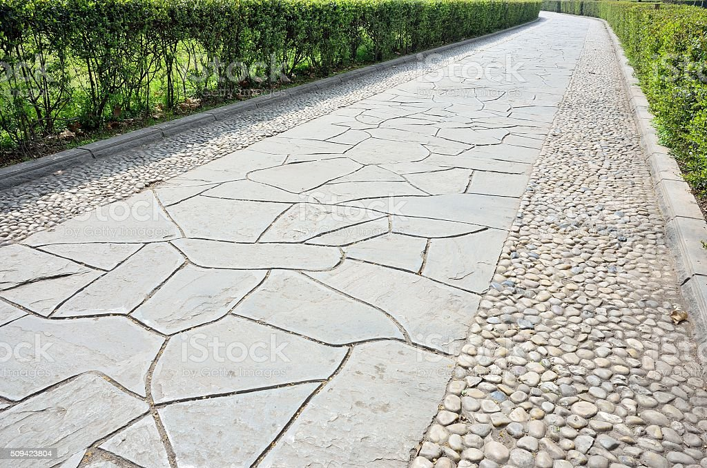Stone brick footpath in the garden stock photo
