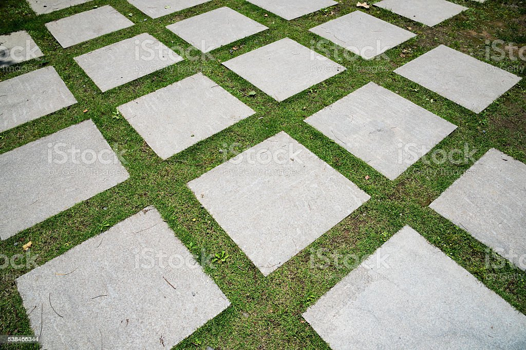 Stone brick footpath in the park stock photo