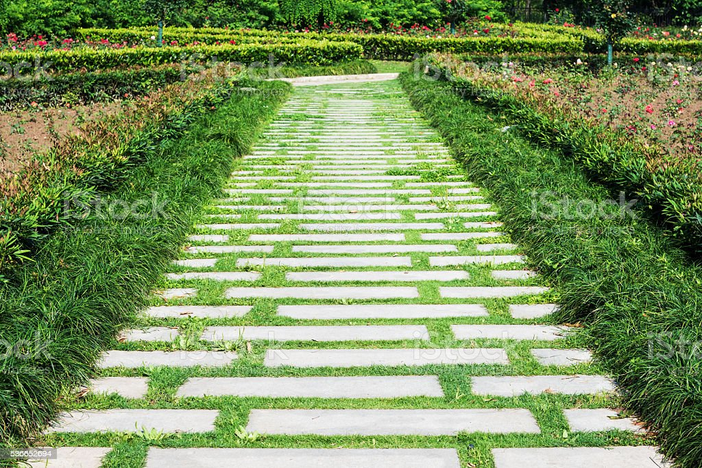 Stone brick pathway in the park stock photo