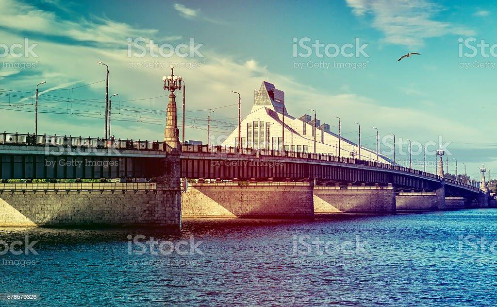 Stone bridge and building of public library, Riga stock photo