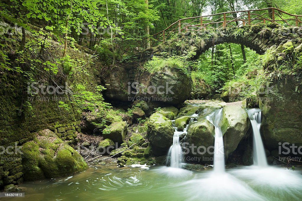Stone bridge and waterfalls in Mullerthal, Luxembourg stock photo