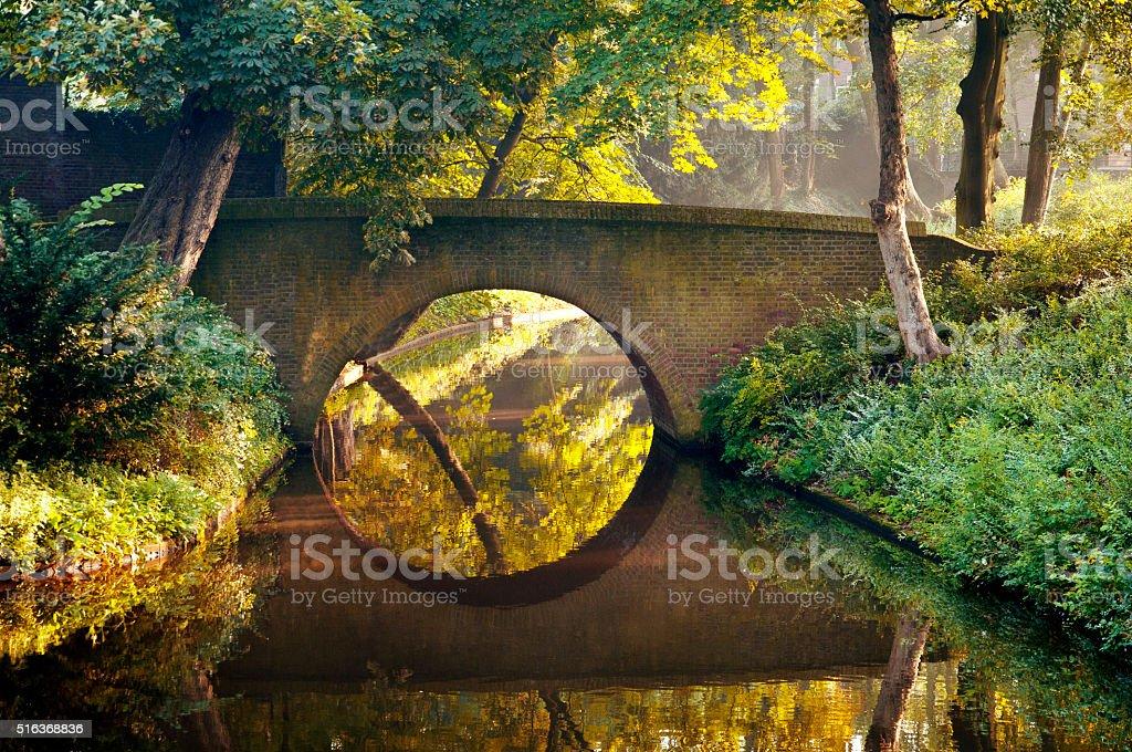 Stone bridge in a park stock photo