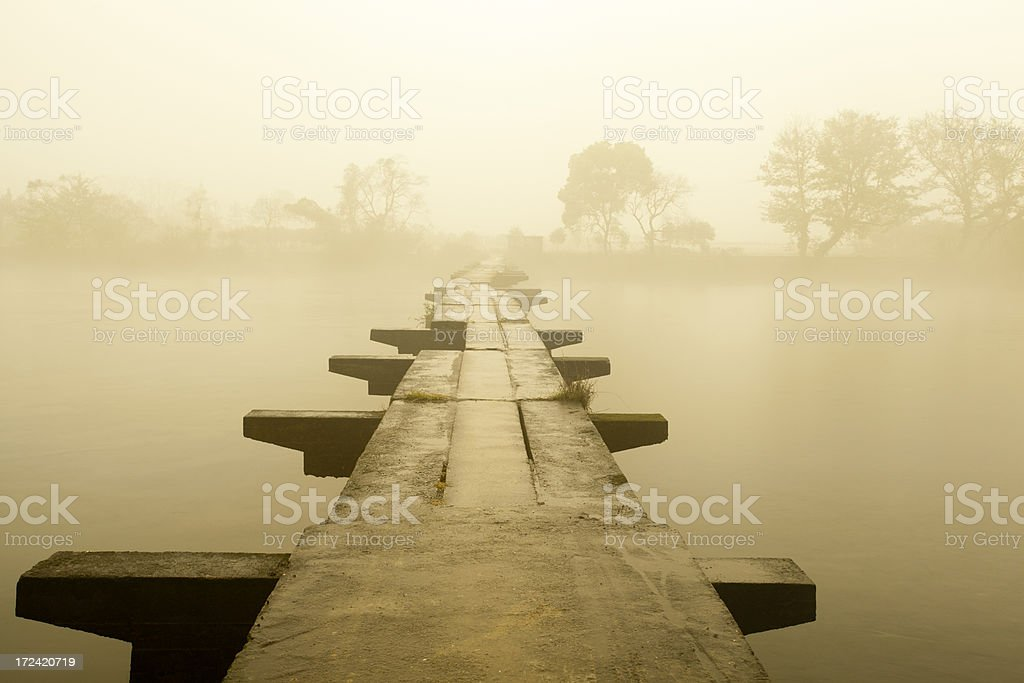 Stone bridge in fog royalty-free stock photo