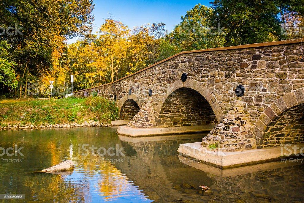 Stone bridge over a creek in Adams County, Pennsylvania. stock photo