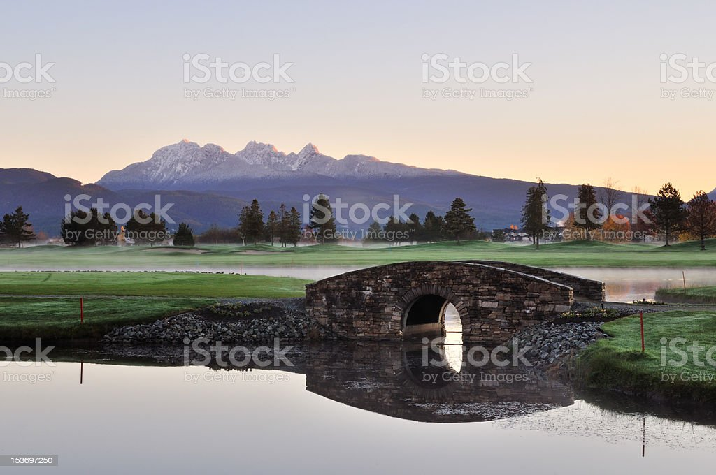 Stone bridge over creek on golf course stock photo