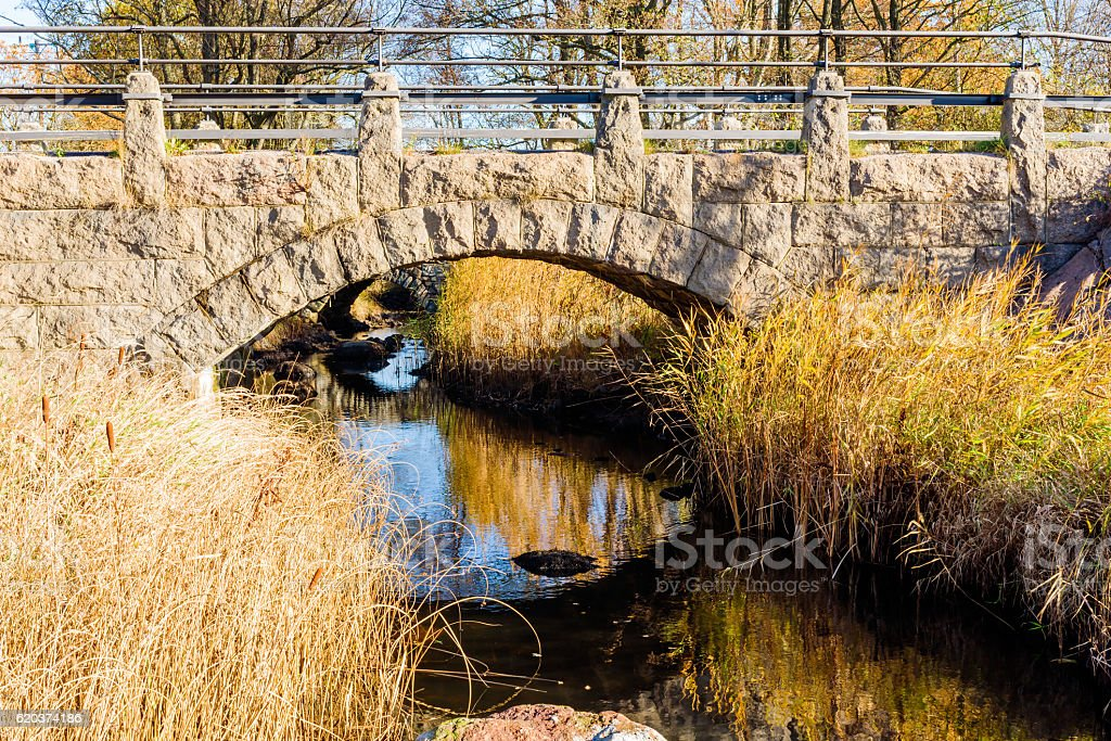 Stone bridge over stream stock photo