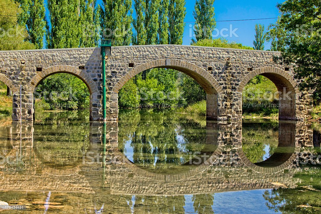 Stone bridge over Zrmanja river stock photo