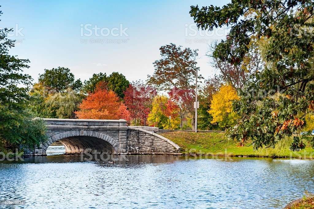 Stone bridge spanning pond stock photo